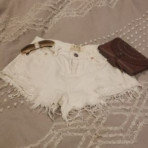 Free people white distressed jean shorts